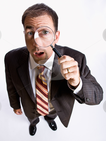Businessman looking through magnifying glass stock photo, Businessman looking through magnifying glass by Jonathan Ross