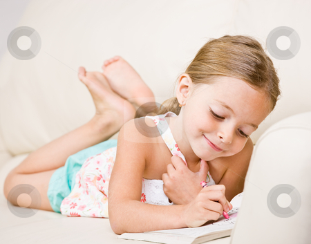 Girl coloring in coloring book stock photo, Girl coloring in coloring book by Jonathan Ross