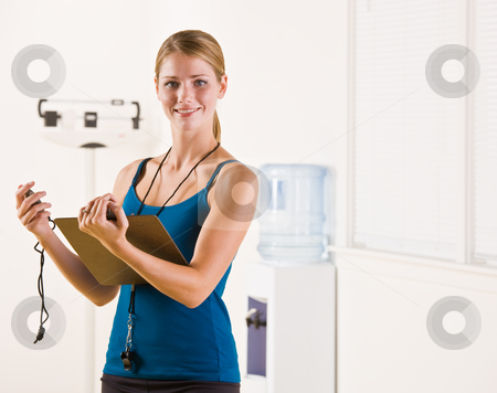 Woman holding stopwatch and clipboard stock photo, Woman holding stopwatch and clipboard by Jonathan Ross