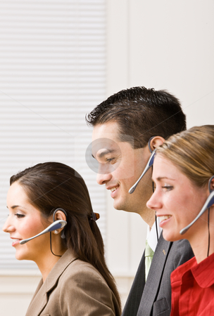 Business people talking on headsets stock photo, Business people talking on headsets by Jonathan Ross