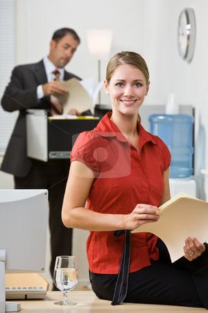Businesswoman holding file folder stock photo, Businesswoman holding file folder by Jonathan Ross