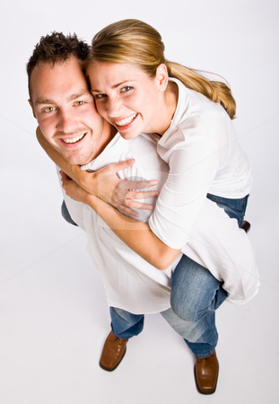 Boyfriend giving girlfriend piggy back ride stock photo, Boyfriend giving girlfriend piggy back ride by Jonathan Ross