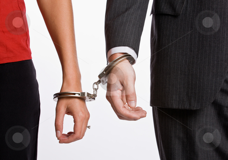 Business people handcuffed together stock photo, Business people handcuffed together by Jonathan Ross