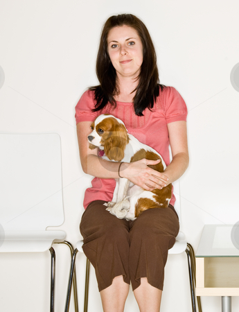Woman holding dog in waiting room stock photo, Woman holding dog in waiting room by Jonathan Ross
