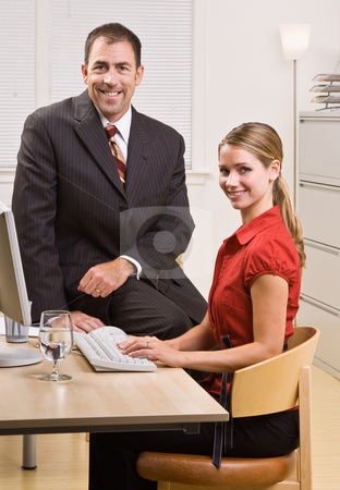 Business people sitting at desk stock photo, Business people sitting at desk by Jonathan Ross