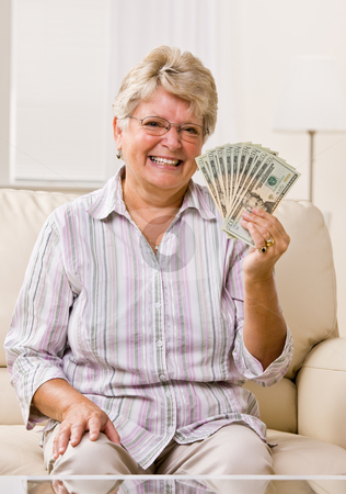 Senior woman holding cash stock photo, Senior woman holding cash by Jonathan Ross
