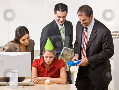 Businesswoman blowing out birthday candle stock photo, Businesswoman blowing out birthday candle by Jonathan Ross