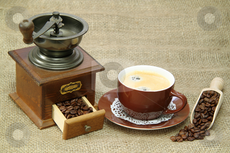 Coffee beans stock photo, Delicious coffee with vintage coffee mill on brown background by Birgit Reitz-Hofmann