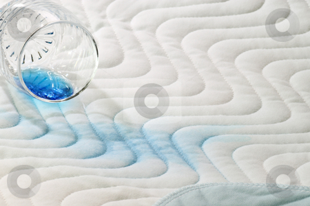 Incontinence stock photo, Protection bed layer with a glass and blue fluid by Birgit Reitz-Hofmann