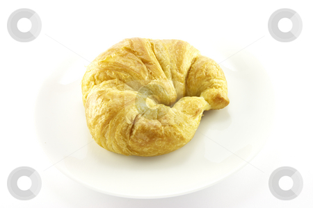 Croissant on a White Plate stock photo, Single golden flakey delicious baked croissant on a white plate with a background by Keith Wilson