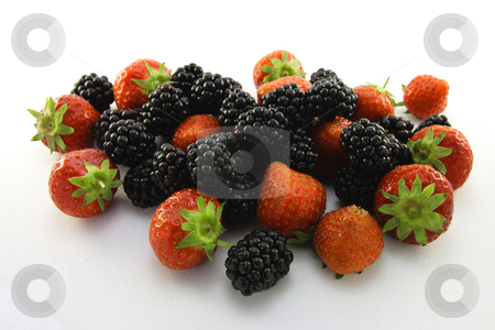 Strawberries and Blackberries stock photo, Delicious juicy ripe strawberries and blackberries on a white background by Keith Wilson