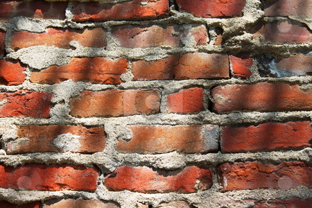 Brick Wall Shadows stock photo, Red brick wall with shadows good as background by Henrik Lehnerer