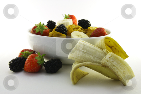 Cornflakes and Fruit in a White Bowl with Banana stock photo, Cornflakes with strawberries, blackberries and banana in a round black bowl on a white background by Keith Wilson
