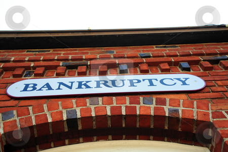 Bankruptcy Sign On Brick Building stock photo, Bankruptcy sign on the front of a red brick building by Lynn Bendickson