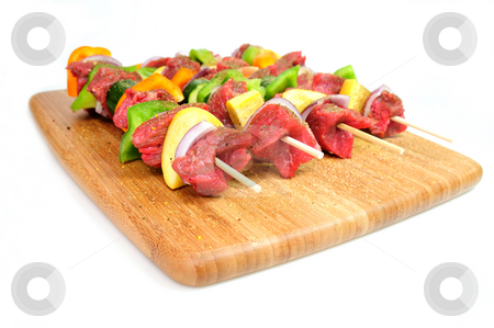 Steak And Vegetabe Kabob's stock photo, Steak and assoreted vegetables including onion, orange and green bell peppers and summer squash on bamboo skewer sprinkled spices ready for the grill. by Lynn Bendickson