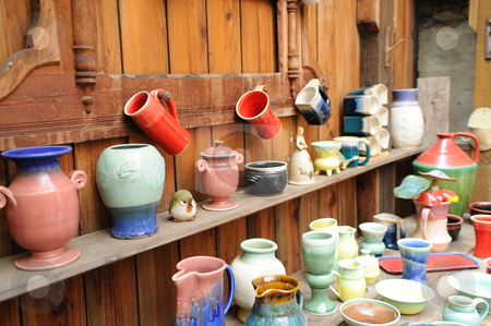 Assorted Ceramic Pottery stock photo, Handmade pottery on display in a rustic setting, vases, cups, bowls and other ceramic items. by Lynn Bendickson