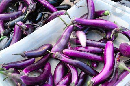 Japanese Eggplant stock photo, Farmers market bins filled with fresh slender purple japanese eggplant. by Lynn Bendickson