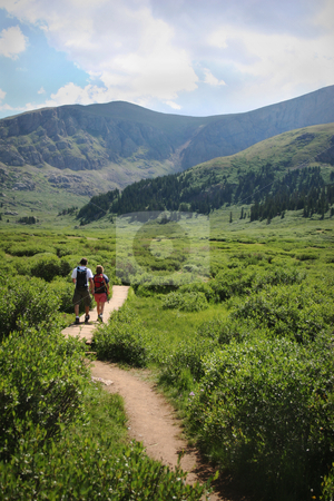Colorado Summer Mountain Backcountry Scene stock photo, Colorado Summer Mountain Backcountry Scene. Couple hiking. Great for themes of nature, summer, mountains, outdoor rereation, travel destinations, background scenics. by Jeff DeMent