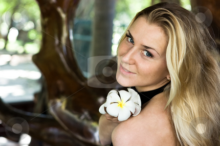 Lady with flower stock photo, Beautiful blonde lady with white tropical flower by Dmitry Rostovtsev