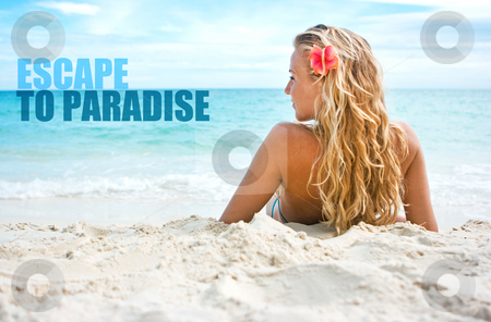 Girl with flower on the beach stock photo, Blonde girl sitting on white sand on the beach and escape to paradise inscription by Dmitry Rostovtsev