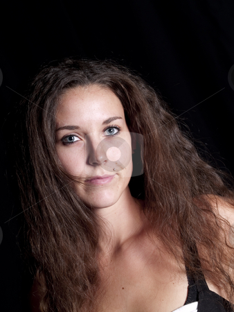 Headshot stock photo, Pretty woman with long hair on black by Cora Reed