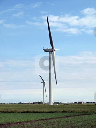 Wind turbine farm in the fens.  stock photo, Wind turbine in  the flat, windy fens of East Anglia. by Ian Langley