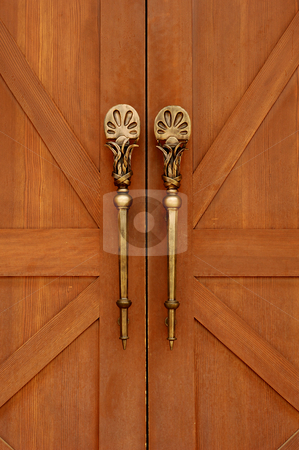 Brass Door Ornament stock photo, Antique doors are accented with beatiful brass handles. by Charles Buegeler