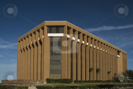 Brick Columns and Glass stock photo, Modern office building with brick columns and glass. by Charles Buegeler