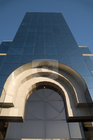 Arch and Glass stock photo, Ultra modern steel and glass office building with arch accent. by Charles Buegeler