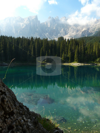Carezza Lake (Karersee) in the Italian Dolomites stock photo, Reflection of the Latemar in the incredibly clear blue Carezza Lake in the Italian Dolomites by Peter Van veldhoven
