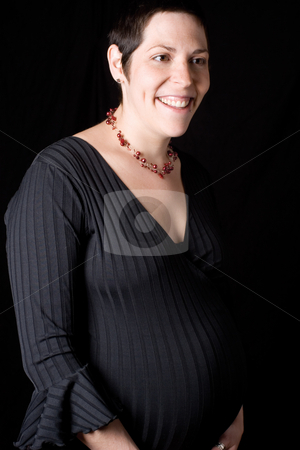 Pregnant Women stock photo, Portrait of a late twenty pregnant women looking perky with a great big smile by Yann Poirier
