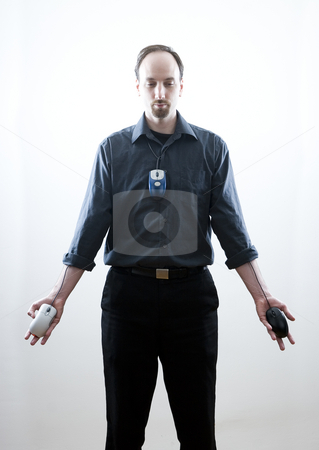 Lord of the mouse stock photo, Thirty something man standing with open palms, call on some religious imagery.  Each palm has a mouse with the wires coming from inside the shirt.  A mouse is also worned as a tie by Yann Poirier