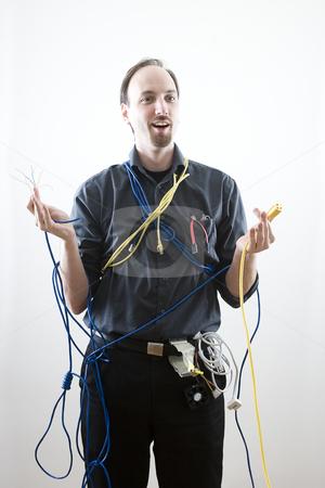 Surprise Technician stock photo, Dumb technician surprise by wires in his hand by Yann Poirier