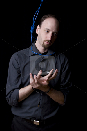 Suicidal technician stock photo, Computer technician with tied hands and hangman noeuce around his neck by Yann Poirier