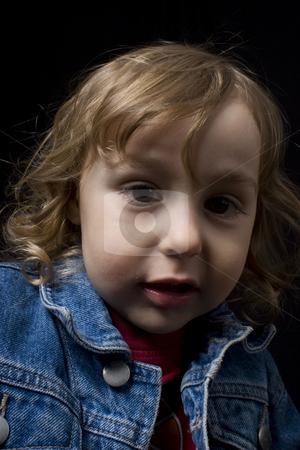 Two year old boy stock photo, Portrait of a two year old boy wearing a jean jacket by Yann Poirier
