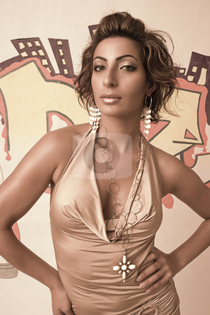 Graffiti fashion model stock photo, Portrait of a twenty something libanese fashion model in front of hip hop inspired graffiti in sepia tone by Yann Poirier