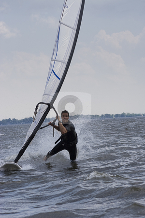 Windsurfer body drag stock photo, Male windsurfer doing the body drag trick by Yann Poirier