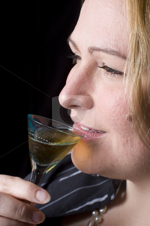Overweight women having a drink stock photo, Portrait of a thirty something overweight women in evening clothes having a drink of brown rum by Yann Poirier