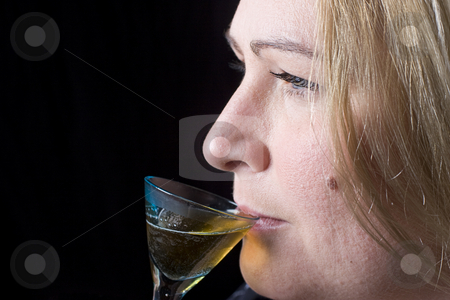 Overweight women having a drink stock photo, Close up portrait of a thirty something overweight women in evening clothes having a drink of brown rum by Yann Poirier