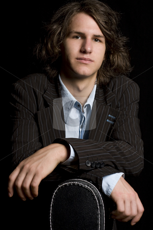 Young musician stock photo, Early twentie male musician leaning on a guitar case by Yann Poirier