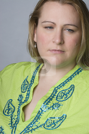 Overweight women looking sad stock photo, Full figure women in casual clothes with sad and depress expression by Yann Poirier