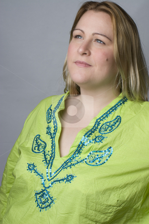 Day dreaming women stock photo, Over weigth women in green wrinkle shirt day dreaming by Yann Poirier