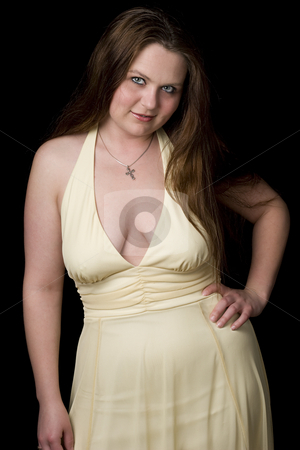 Cute girl in evening dress stock photo, Twenty something girl in yellow evening dress with v shape cleavage line by Yann Poirier