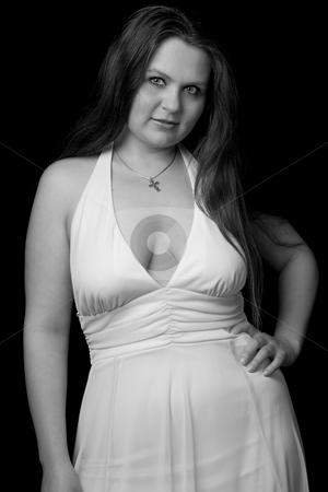 Portrait of a cute girl stock photo, Portrait of a twenty year old girl in black and white by Yann Poirier
