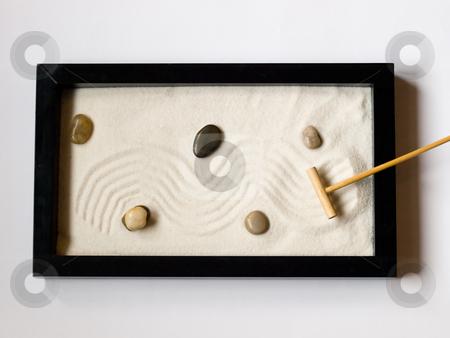 Miniature Japanese zen garden stock photo, Close-up of a a miniature Japanese zen garden with a wooden rake and stones. by FEL Yannick