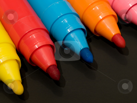 Colored felt pens stock photo, Several colored felt pens with caps off isolated on black background. by FEL Yannick