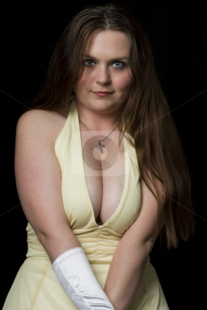 Cute girl in evening dress stock photo, Prom queedn in yellow evening dress with v shape cleavage line by Yann Poirier