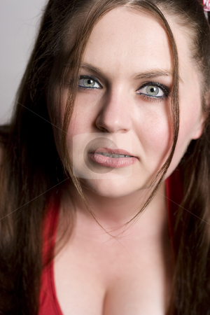Growling stock photo, Twenty something girl in red binikin with growling expression by Yann Poirier