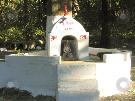 Village shrine stock photo, A small local shrine in amongst the trees corbett national park india by Mike Smith