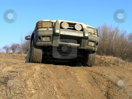 Land rover discovery offroad in the mud stock photo, Land Rover discovery climbing the hill in th emud by Stanislav Vasko